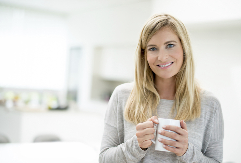 Woman with warm drink